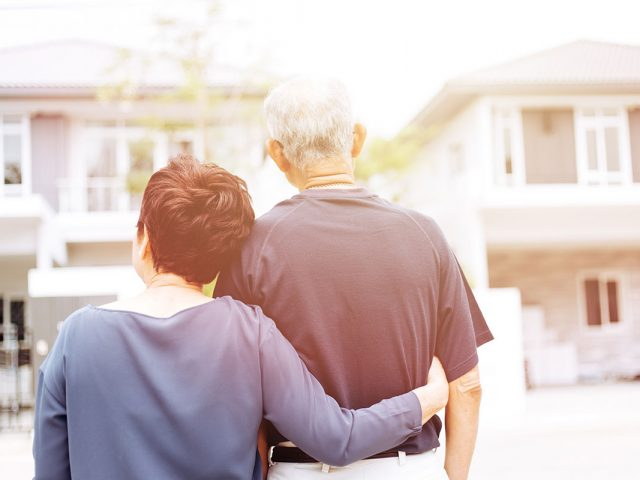 Old-couple-backs-facing-a-home